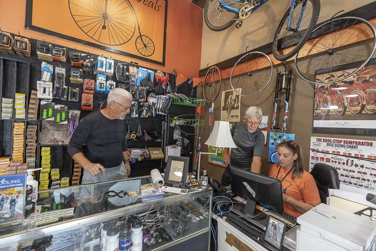 Mike (left), Mark (center) and Wheels Deals employee Nicole Bertram (right) can be seen working together in the shop back in 2019. Photo by Mike Schultz