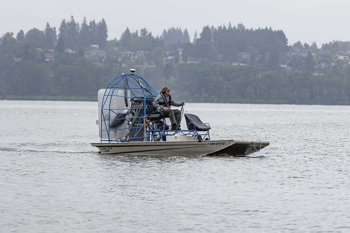 Applicator Terry McNabb of Bellingham-based AquaTechnex LLC is shown here on July 7 applying treatment to eradicate Eurasian Milfoil at Vancouver Lake. Photo by Mike Schultz