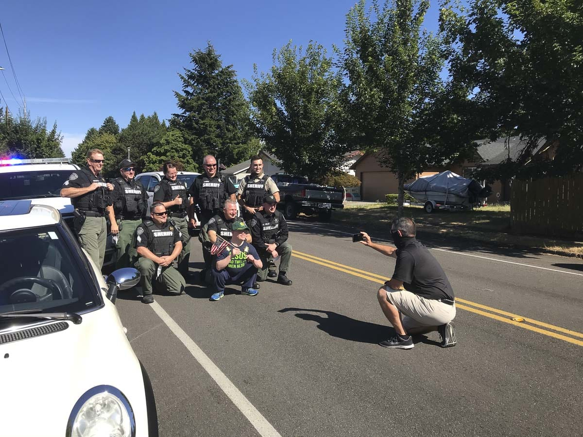 Aaron Robinson (middle) poses for a photo here with Clark County Sheriff's deputies during his surprise drive-by birthday. Photo courtesy of Rod Robinson