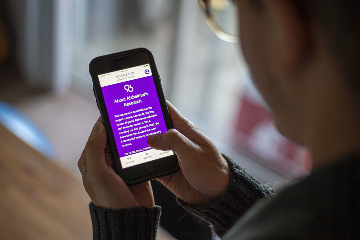 The Alzheimer's Association recently launched their science hub app for Android and iOS, which fact-checks Alzheimer's science and provides up-to-date info on disease research. Photo illustration by Bailey Granneman