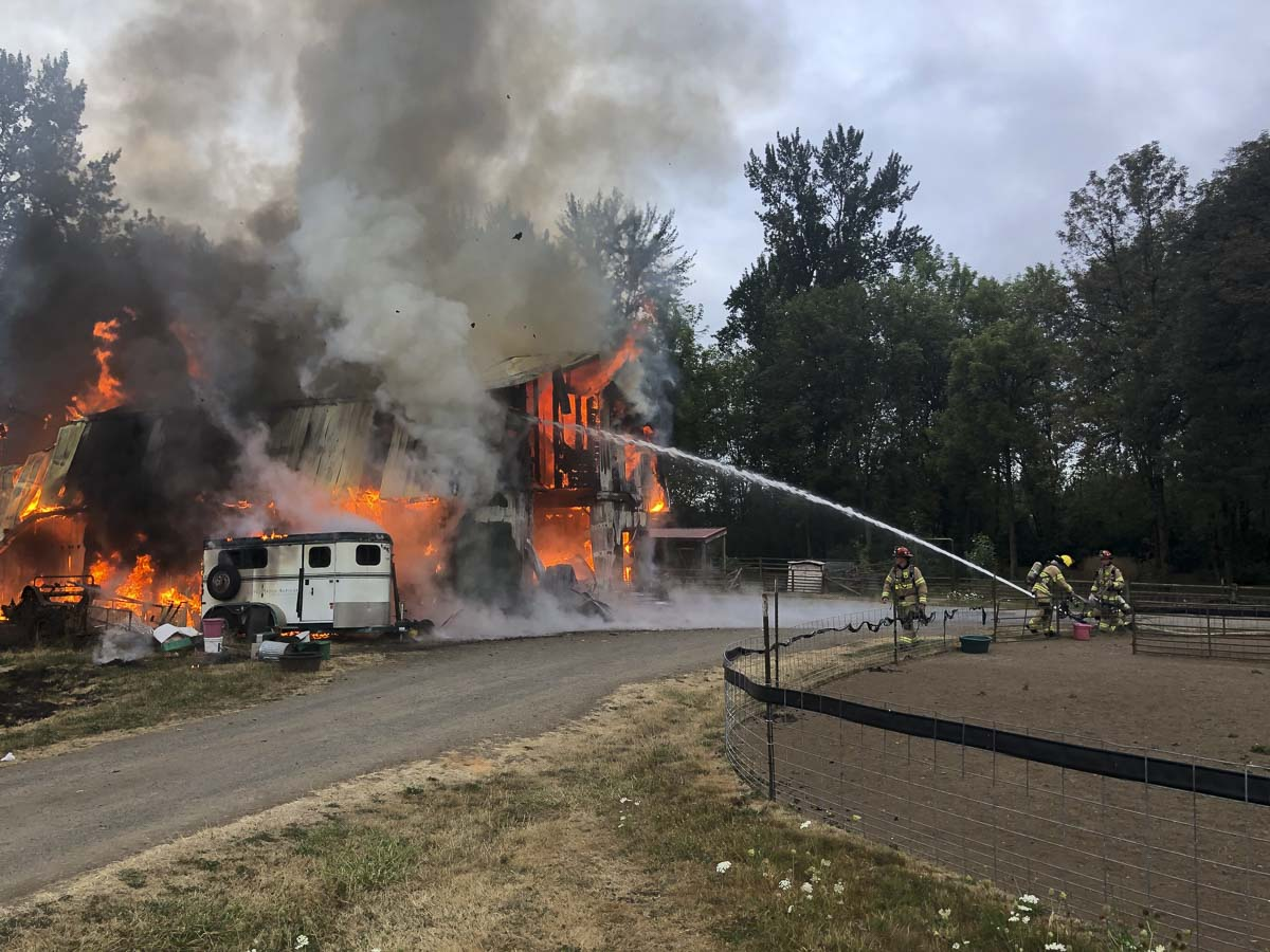Firefighters are shown here flowing water from the outside to control the fire. Photo courtesy of Clark County Fire & Rescue