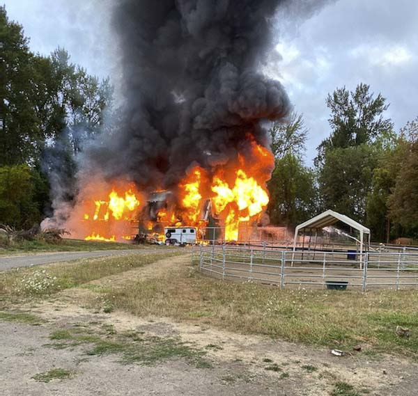 The fully involved barn is shown here as firefighters prepare to apply water. Photo courtesy of Jennifer Fowler