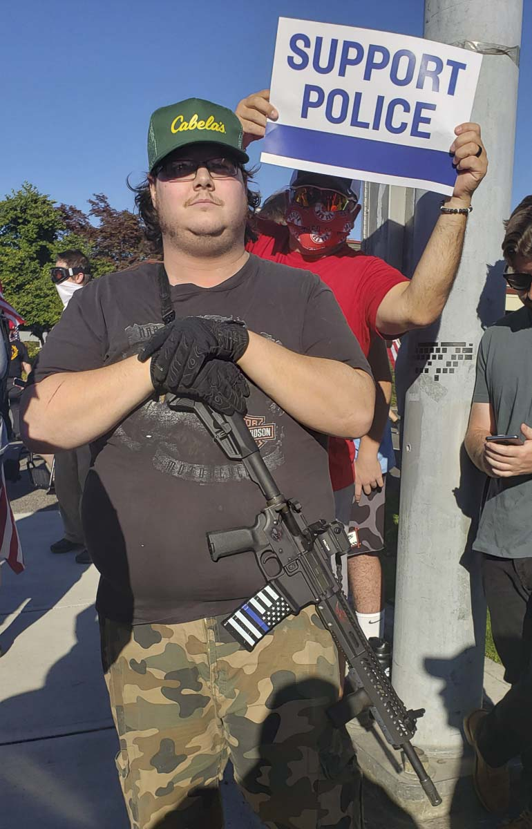 Jeremy of Washougal said he brought his AR-15 to the rally for self defense only. Photo by Paul Valencia