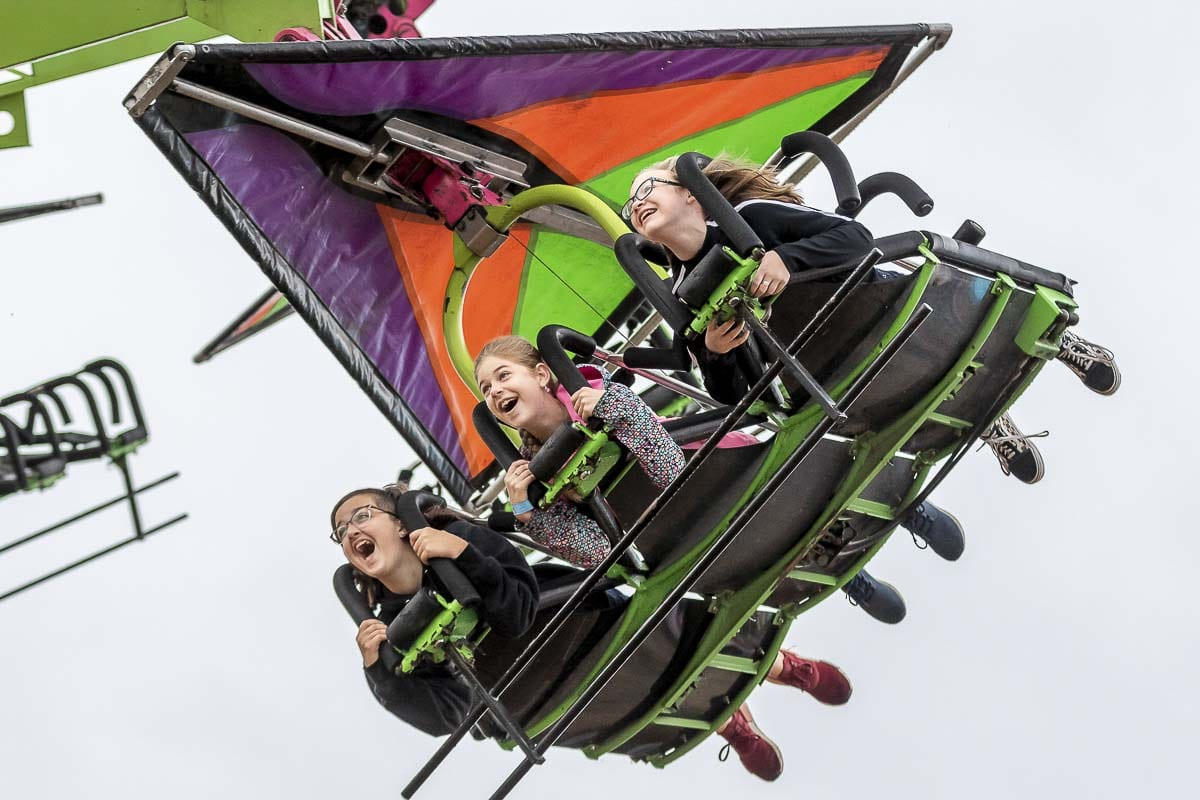 Molly Walther, Carolyn Howard, and Maggie Hart had a blast last year on the rides at Clark County Fair. Fairgoers will have to wait another year to return to the fair. Photo by Mike Schultz