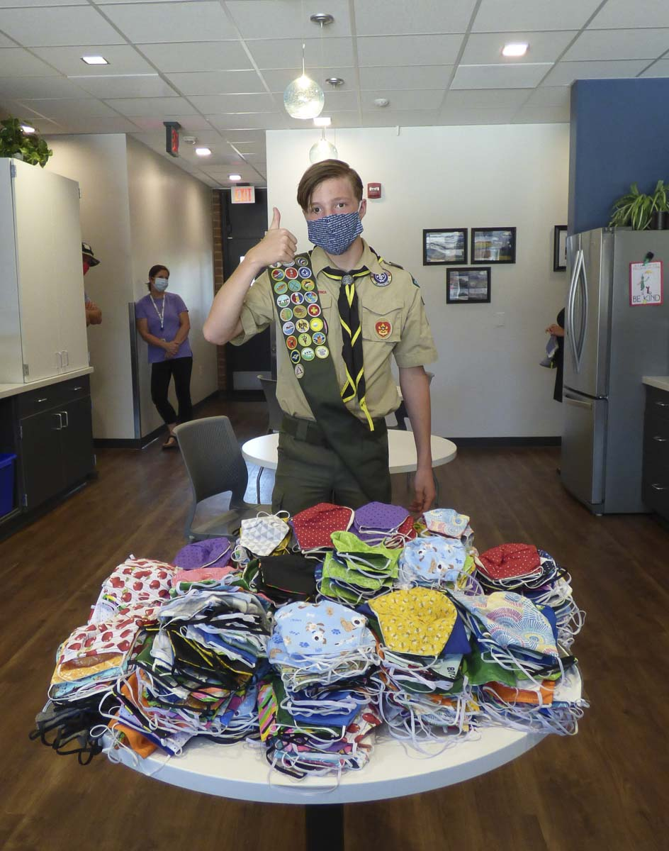 Gavin Gannon displays the cloth masks he completed for his Eagle Scout service project. Photo courtesy of Ridgefield Public Schools