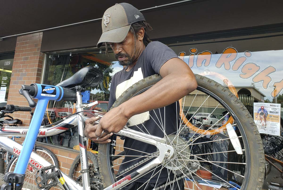 Edward Eley, owner of Rollin Right Bike Repair and Services, works on a bicycle earlier this week. Eley said business has been crazy as more people get back to bicycles during the pandemic. At the same time, shop owners are dealing with a parts shortage. Photo by Paul Valencia