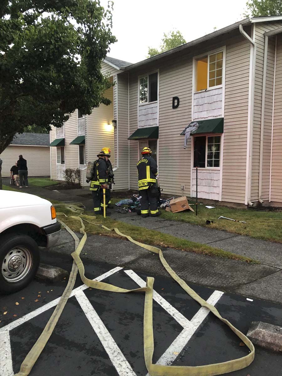 The first engine arrived at Saturday's fire within four minutes, and found a second floor apartment with light gray smoke coming from the windows and doors. Photo courtesy of Vancouver Fire Department