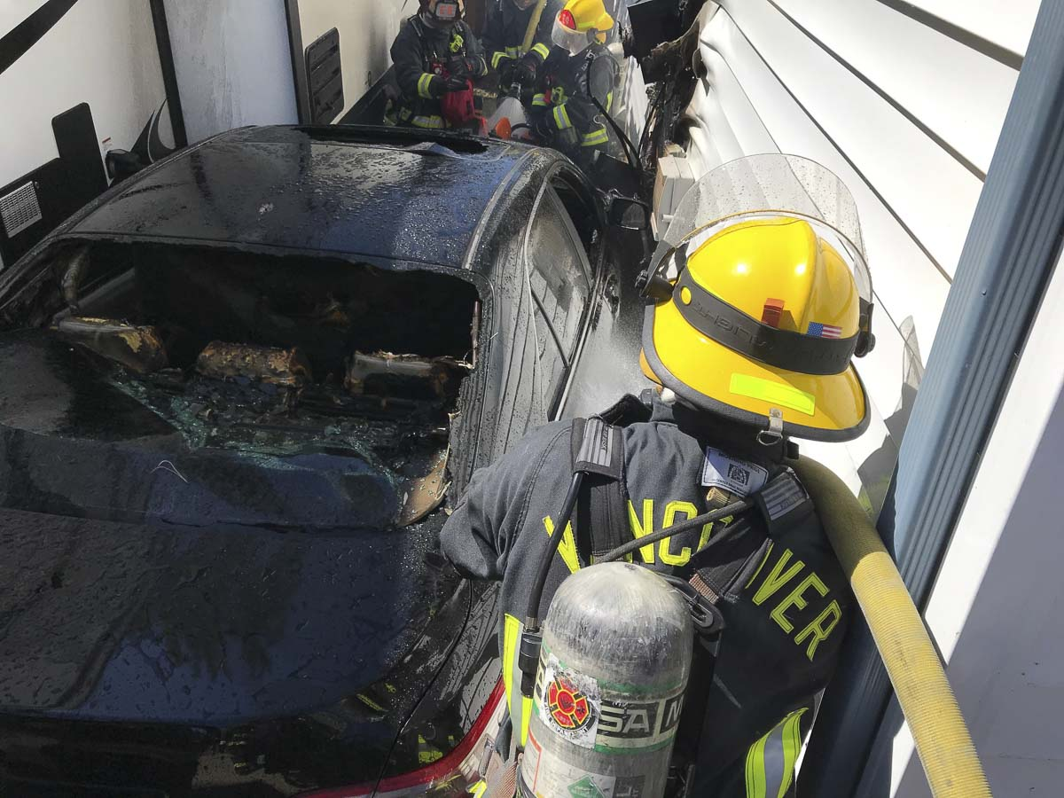 The first two arriving engine companies worked quickly to contain the fire to the involved vehicle and outside wall of the two-story, single-family residence. Photo courtesy of Vancouver Fire Department