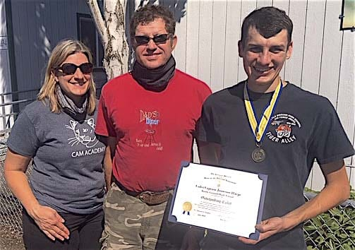 Battle Ground High School senior Jameson Harpe has been awarded the Sons of The American Revolution Bronze Medal and Certificate for his outstanding accomplishments while a member of the school's Air Force JROTC program. Harpe (far right) is shown here with his parents Eric and Diane Harpe. Photo courtesy of Jeff Lightburn