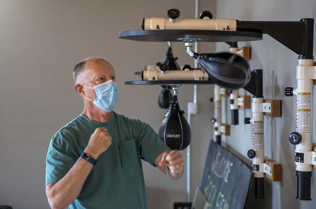 Parkinson's patient John McCullum is seen here practicing his boxing skills with the specialized training for Parkinson's patients. Photo by Jacob Granneman