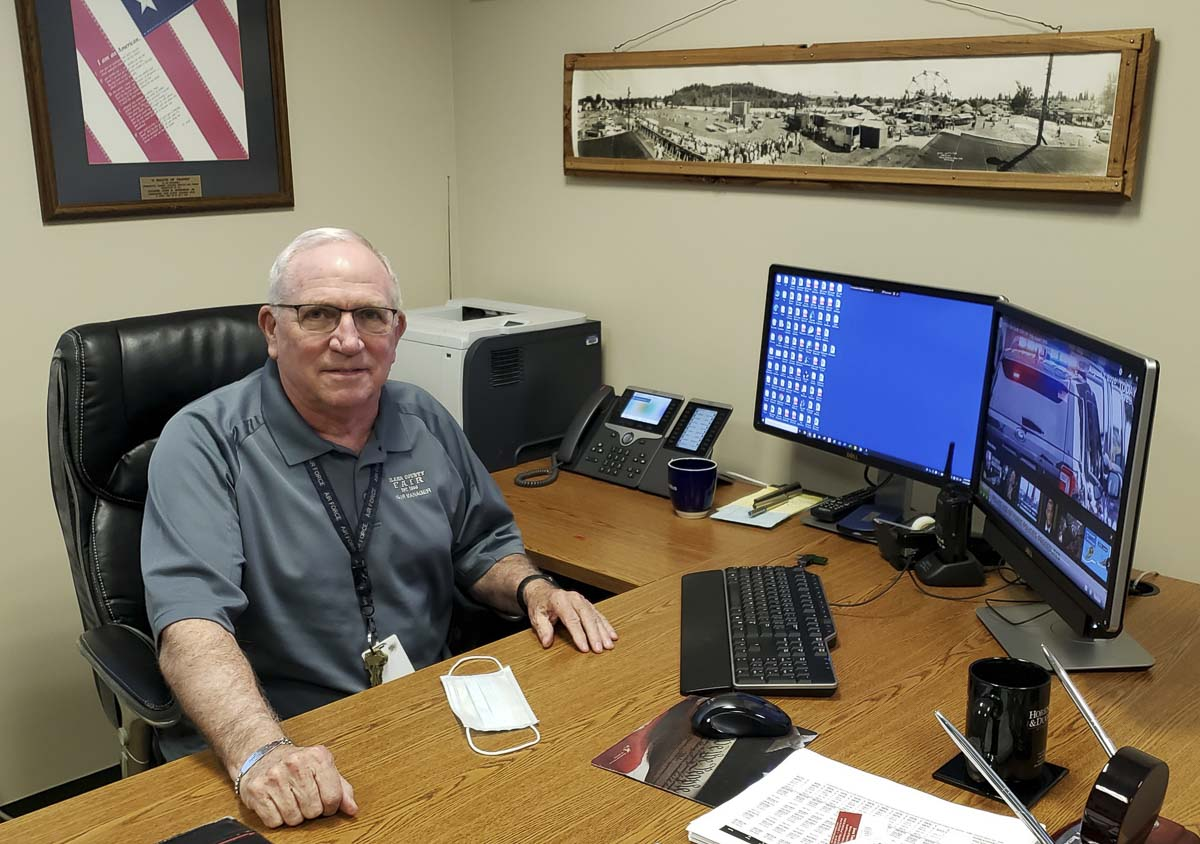 John Morrison Jr., the fair manager and CEO of the Clark County Fair, works at his desk this week. It is quiet at the fairgrounds this year, in what would have been the middle of the 2020 fair. Instead, Morrison and staff are looking forward to 2021. Photo by Paul Valencia