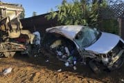 Two injured in collision involving dump truck and car