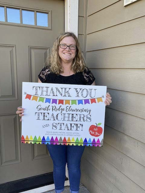 South Ridge Elementary School teacher Kristen Paradis was happy to receive a yard sign from principal Jill Neyenhouse. Photo courtesy of Ridgefield Public Schools