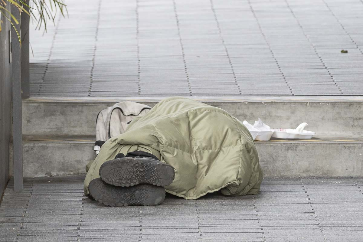 A homeless resident sleeps outside of the Clark County Public Services Building in March. Photo by Mike Schultz
