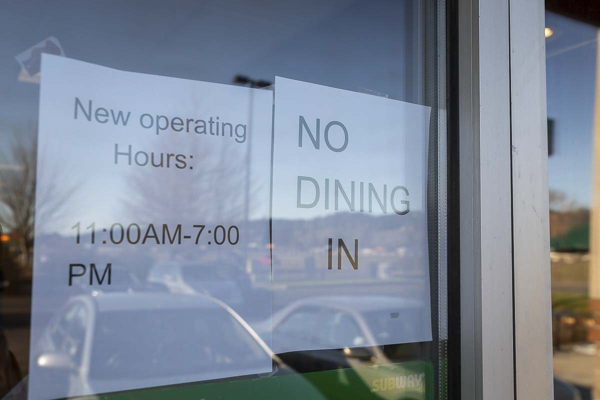 A sign in a Woodland Subway window last March informed customers that the dine-in area was closed. Photo by Mike Schultz