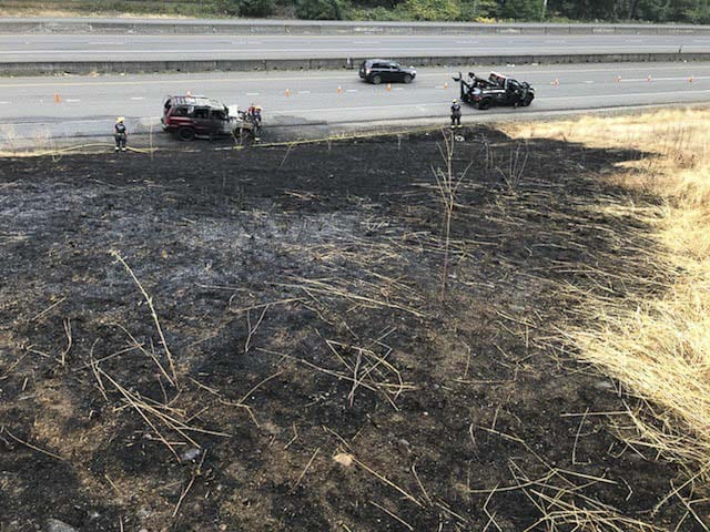 A sport utility vehicle caught fire Wednesday evening on the shoulder of Highway 14 and the fire spread into dry grass along the highway. Photo courtesy of Vancouver Fire Department