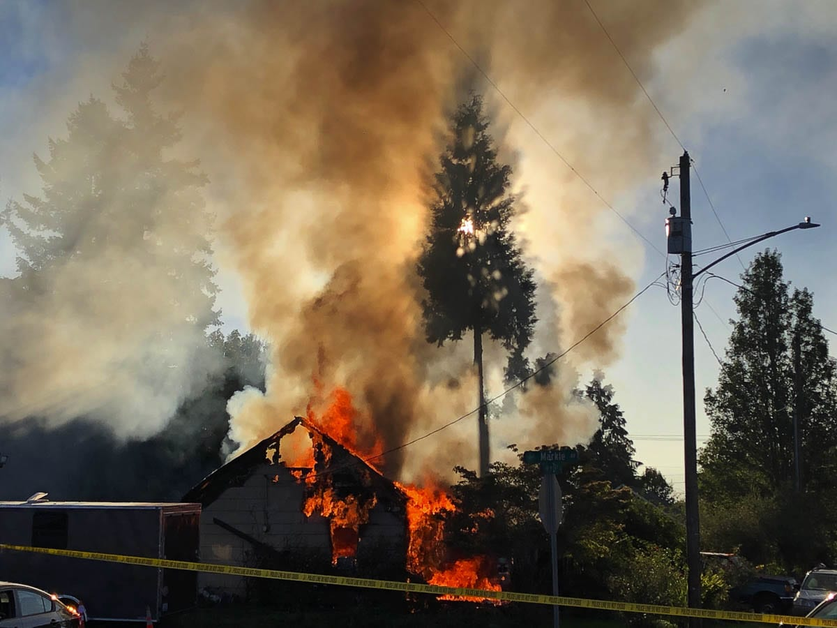 Flames consume a house on 19th Street near downtown Vancouver on Monday afternoon. Photo by Mike Schultz