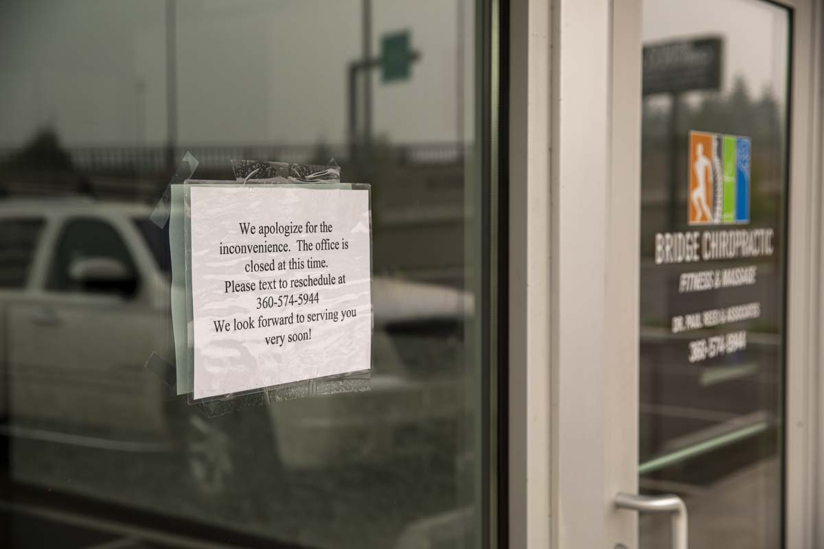 A sign on Bridge Chiropractic in Salmon Creek says the business is temporarily closed. Clark County Public Health says an employee tested positive for COVID-19. Photo by Jacob Grannmenan
