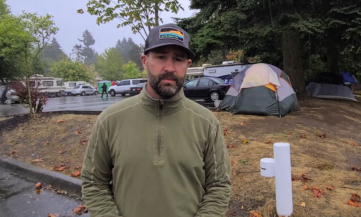 Bart Hansen, a member of the Vancouver City Council, toured the Leverich Park area on Wednesday to get a look at the homeless camps at a parking lot and on nearby trails. Photo by Paul Valencia