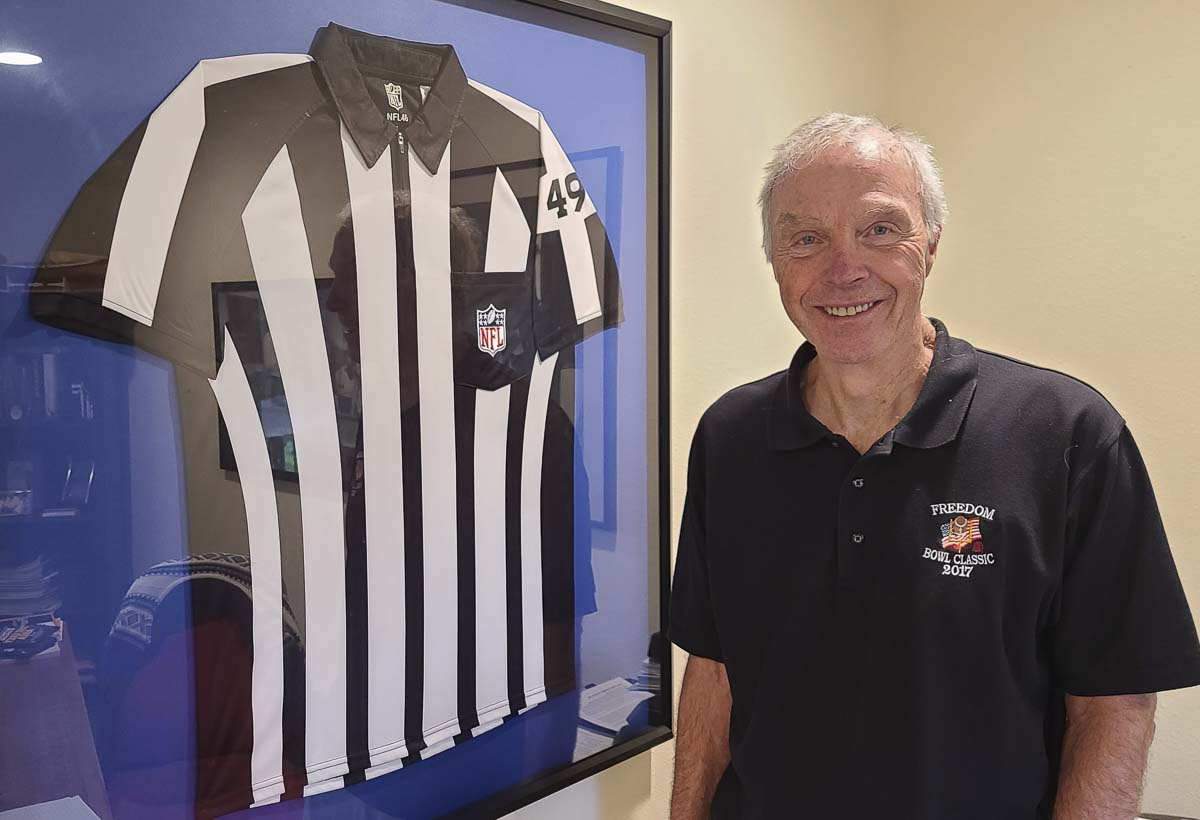 Bruce Hermansen, the president of the Evergreen Football Officials Association, is proud of his seven weeks working as a referee in the National Football League back in 2012. Photo by Paul Valencia
