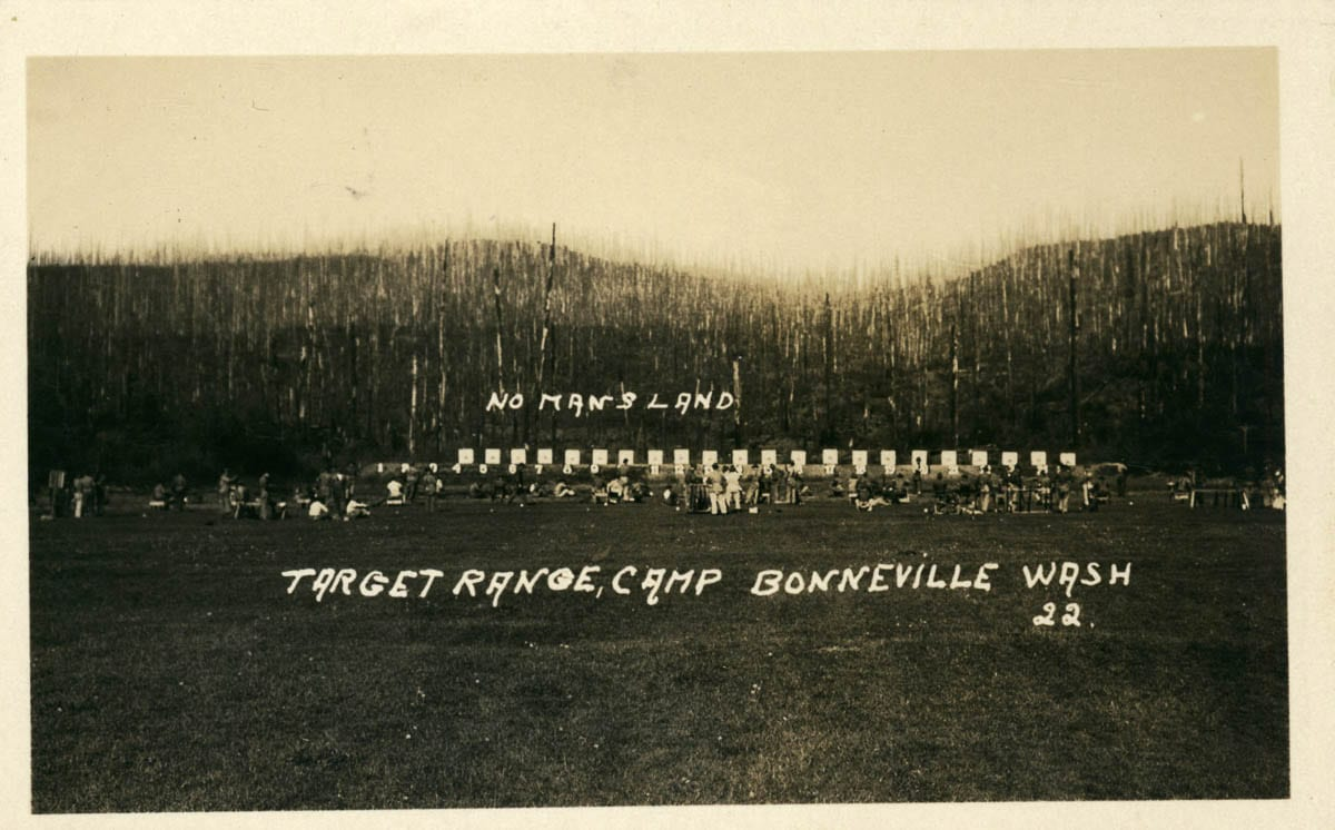 The target shooting range at Camp Bonneville can be seen here with charred forest snags along the range in the background. This image dates to circa 1905; a mere three years after the fire. Photo courtesy of CCHM