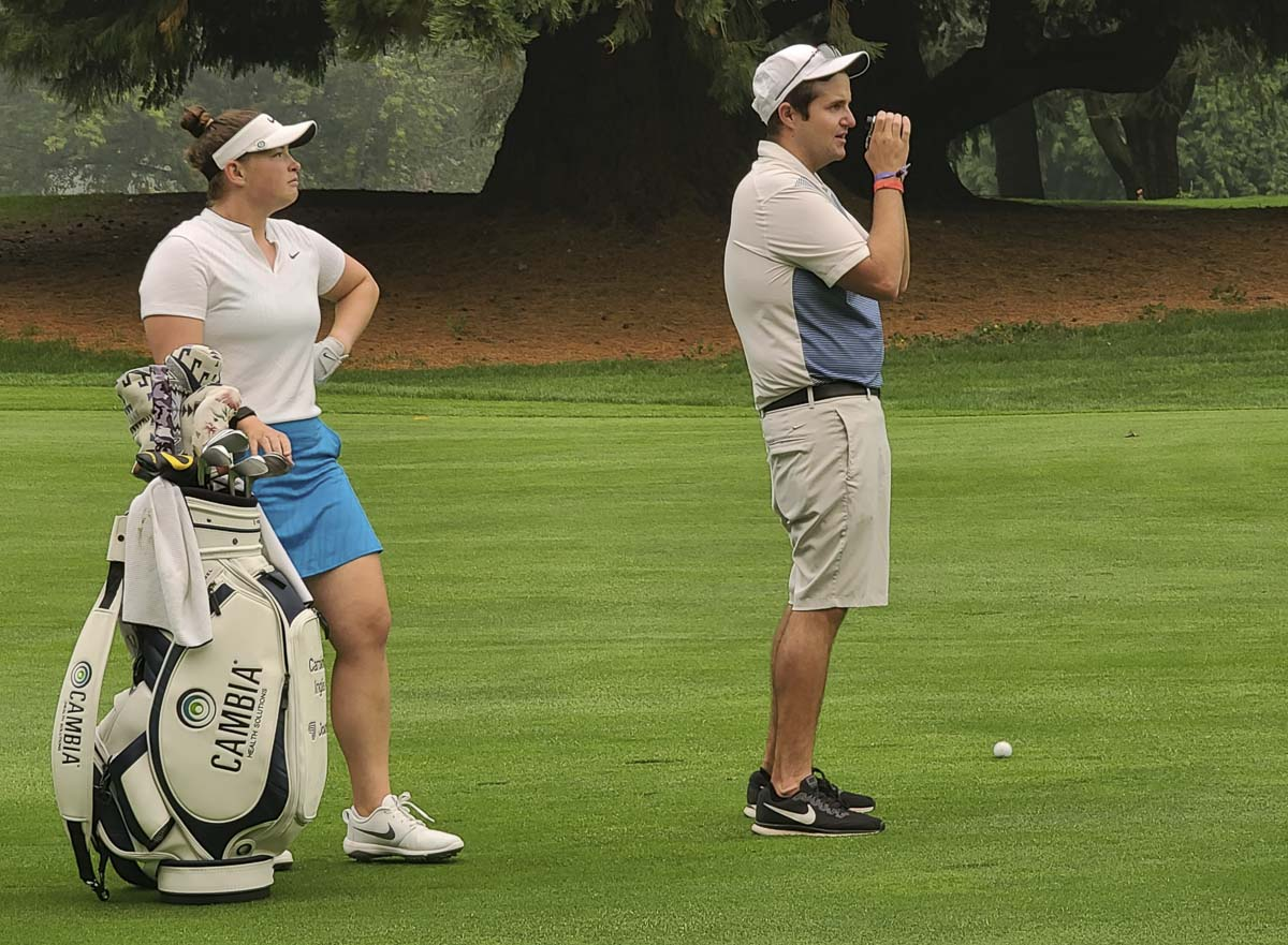Caroline Inglis waits for her caddy (and husband) Taylor Klopp to find the right yardage during a practice round Thursday for the Cambia Portland Classic. Photo by Paul Valencia