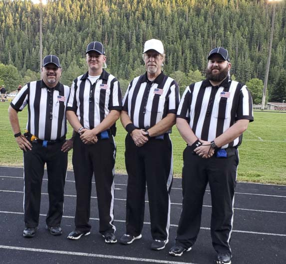 Todd Bingham (white hat) met his crew for the first time about an hour before the game. Bingham, a longtime high school football official from Vancouver, found a game to work in Idaho last week. Photo courtesy of Todd Bingham