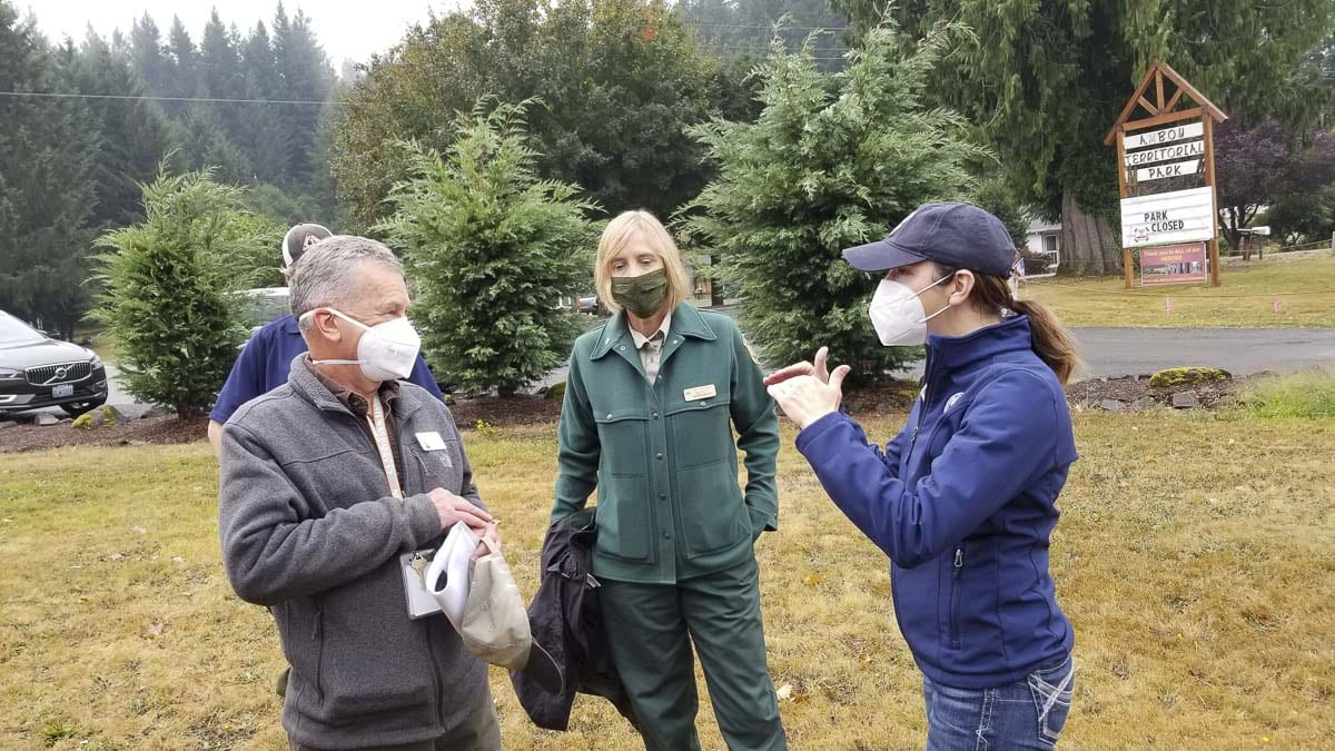 Public Lands Commissioner Hillary Franz and Clark County Councilor Gary Medvigy share concerns about the fires, as Gala Miller of the US Forest Service listens prior to the start of the briefing. Photo by John Ley