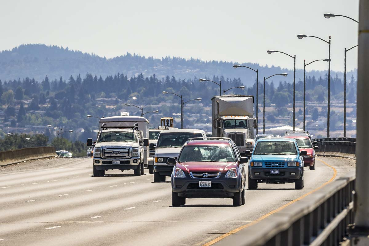 Drivers are shown here crossing the I-205 Bridge, traveling from Oregon into Washington. More than 70,000 Clark County residents commute to Oregon for work each week. Photo by Mike Schultz