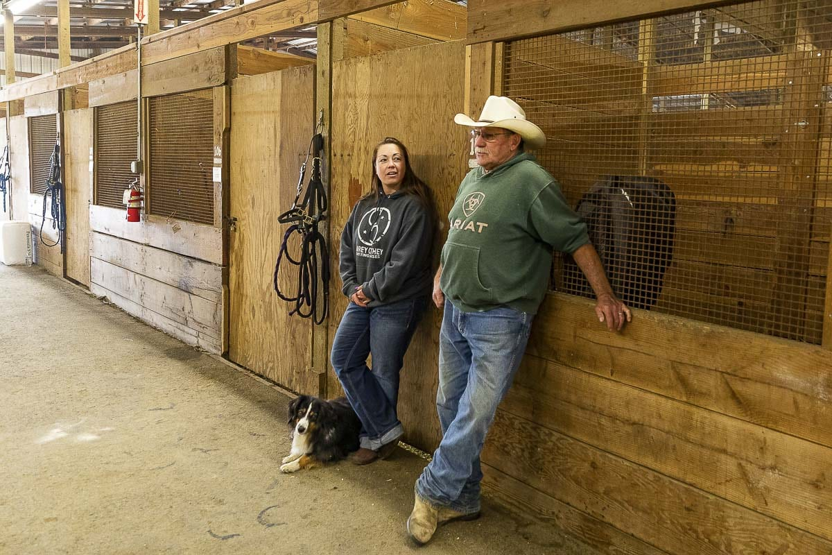Kati and JR Anderson of Soulmate Ranch in Estacada, Oregon talk about evacuating their horses and finding shelter at Clark County Fairgrounds. Photo by Mike Schultz