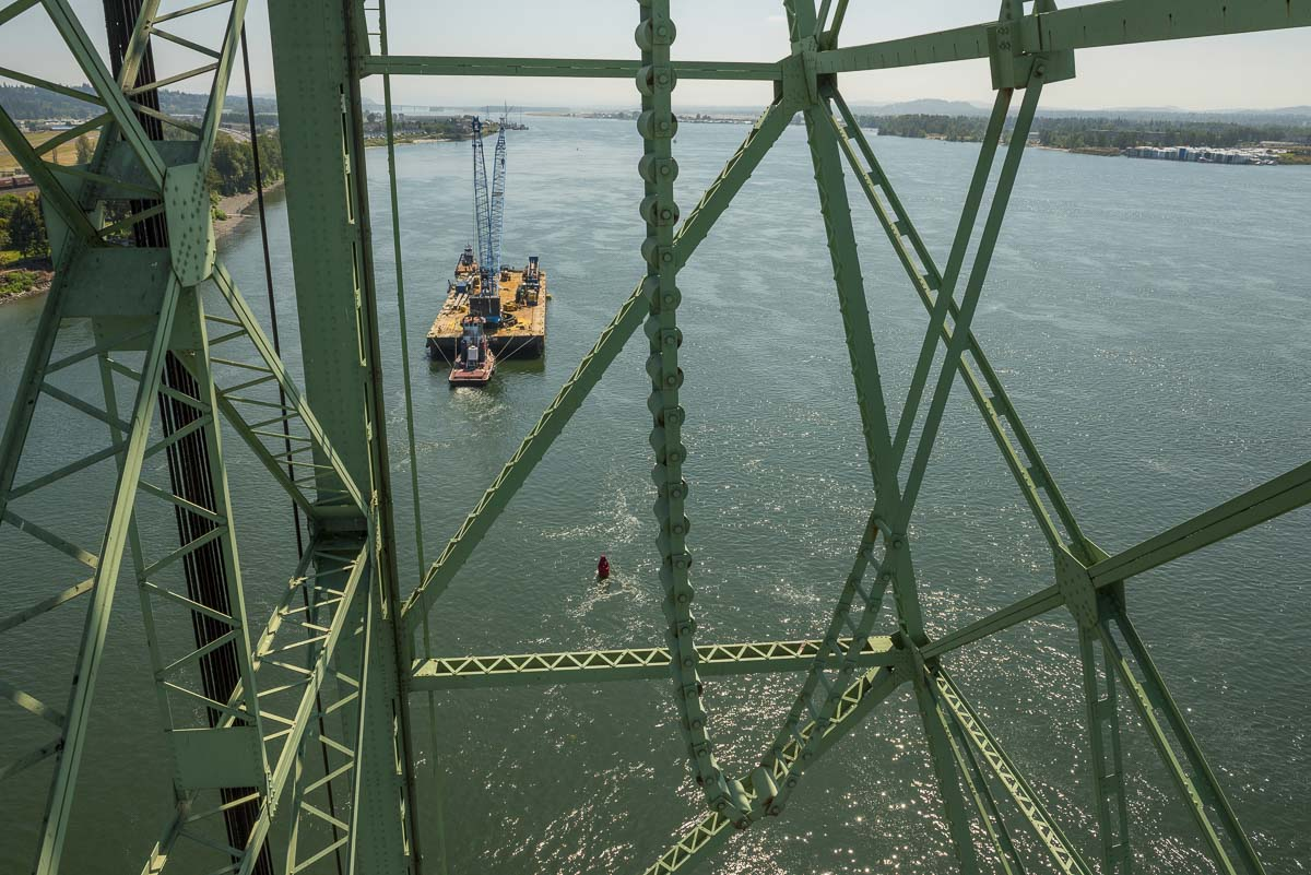 The crane barge carrying the trunnion components for the I-5 Bridge can bee seen here on the Columbia River. Photo courtesy of Oregon Dept. of Transportation