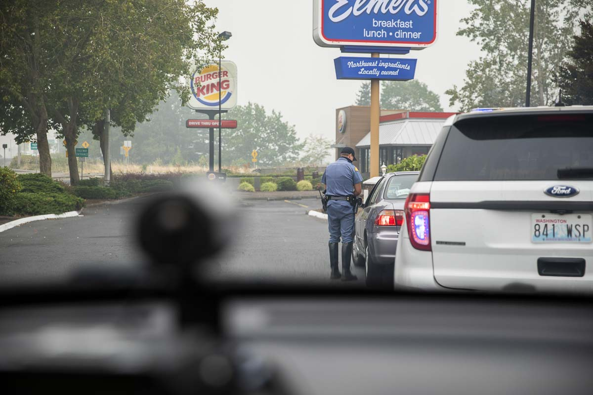 Trooper Tyler Preston searches state databases for the license of a man suspected of driving distracted near I-205 and Mill Plain. Photo by Jacob Granneman