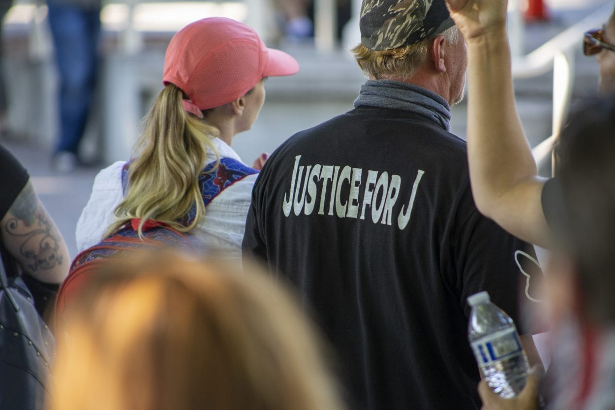 """Many in the crowd wore """"Justice for J"""" T-shirts, since Aaron Danielson was known by many as Jay. Photo by Jacob Granneman"""