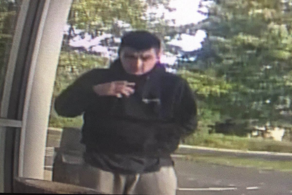 Vancouver Police released this screen capture of security footage at the IQ Credit Union on NE Vancouver Mall Drive on Thursday. The suspect, Anthony Sollers, later turned himself in. Photo courtesy Vancouver Police Department