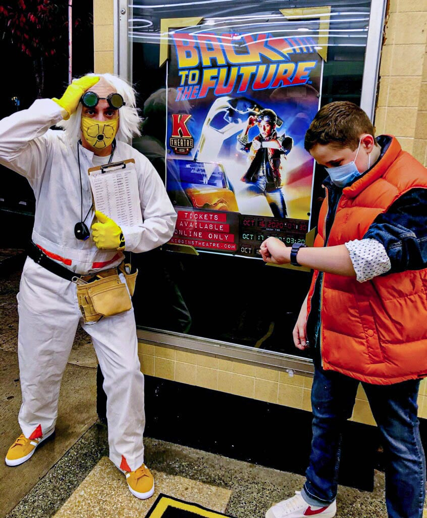 Kiggins Theatre owner Dan Wyatt, as Doc Brown, and his son Tucker, as Marty McFly, welcomed movie goers to the reopening of Kiggins Theater. Rumor has it Doc Brown will return this weekend with Back to the Future Part II. Photo courtesy Dan Wyatt