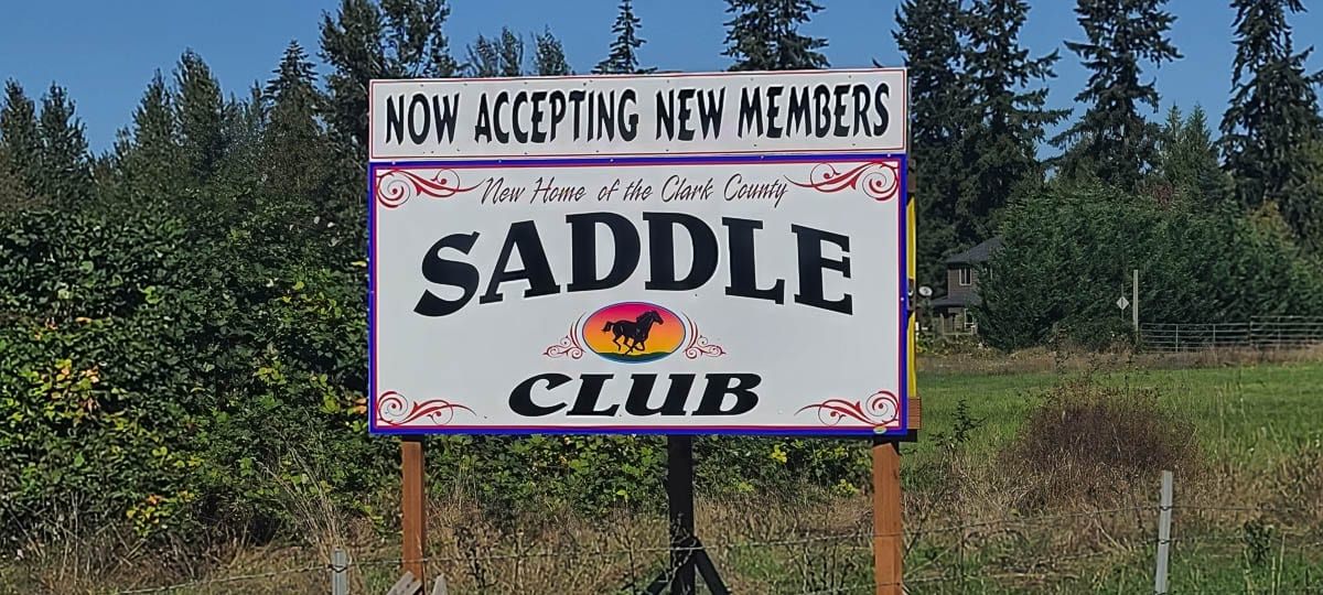 A sign sits just off Washington State Route 503 near Battle Ground, the future home of the Clark County Saddle Club. Photo by Paul Valencia