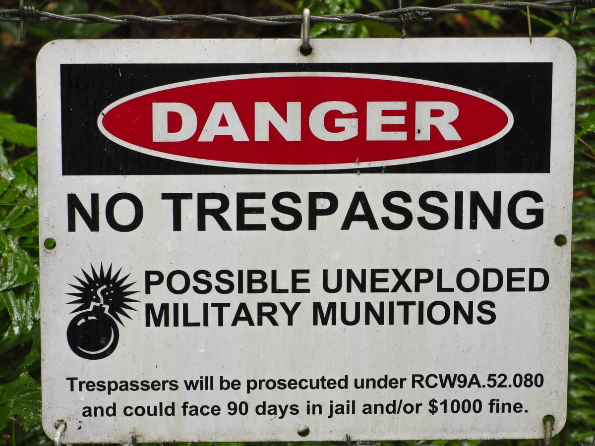 Signs warning people of unexploded ordnance are posted at Camp Bonneville, a former military barracks and training ground. Photo courtesy Clark County Public Works