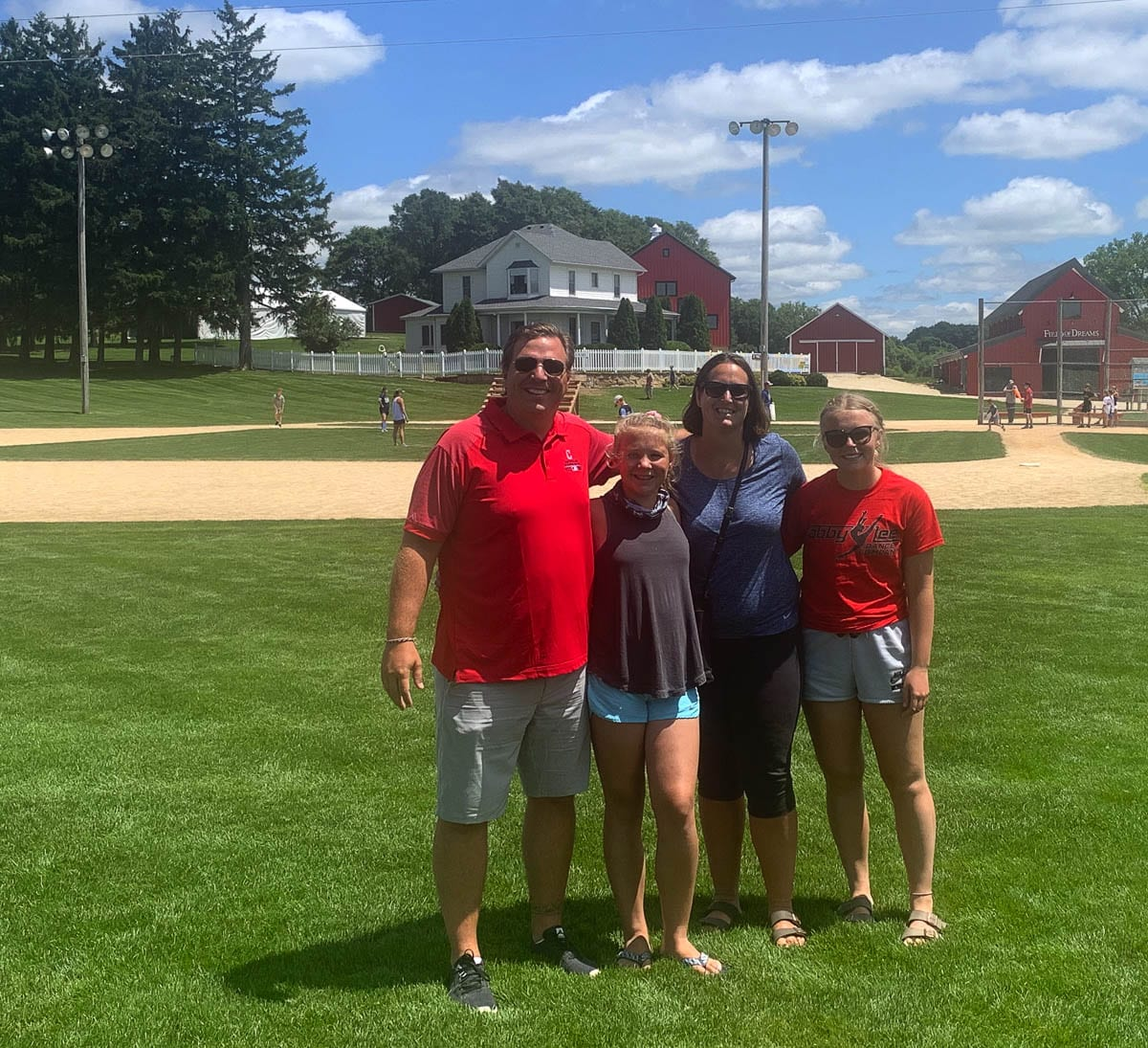 Is this heaven? No, it's the Castro family in Iowa. The Castros, movie buffs and historians, traveled the country to seek out locales of famous movies such as this baseball field in Iowa, home of Field of Dreams. Photo courtesy of the Castro family