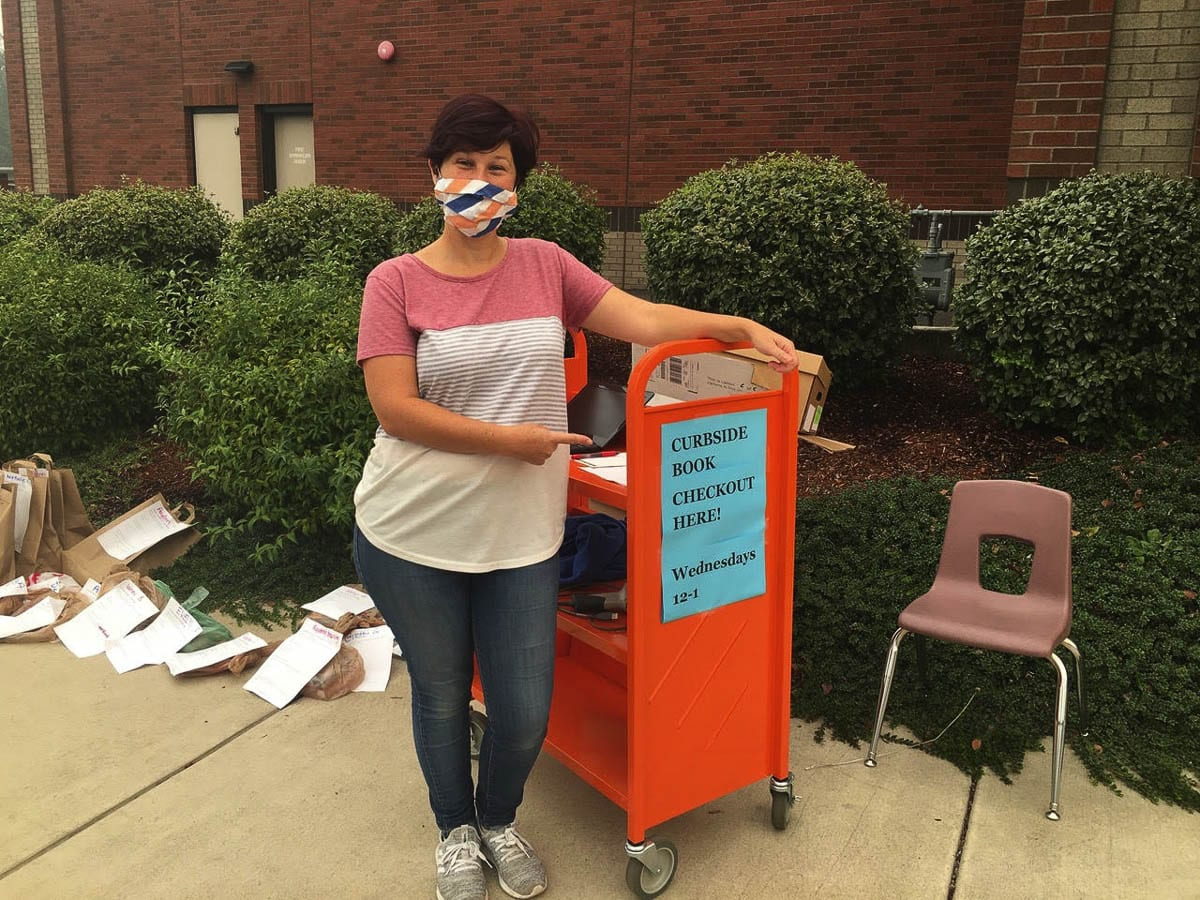 Union Ridge Elementary School librarian, Jubilee Roth, is ready to hand out books with the new Curbside Checkout program. Photo courtesy of Ridgefield School District