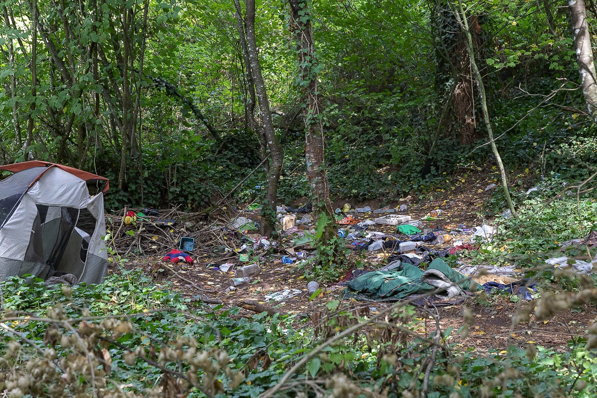 A garbage dump at an abandoned tent site is just a few feet off of the Ellen Davis Trail near Leverich Park. Photo by Mike Schultz