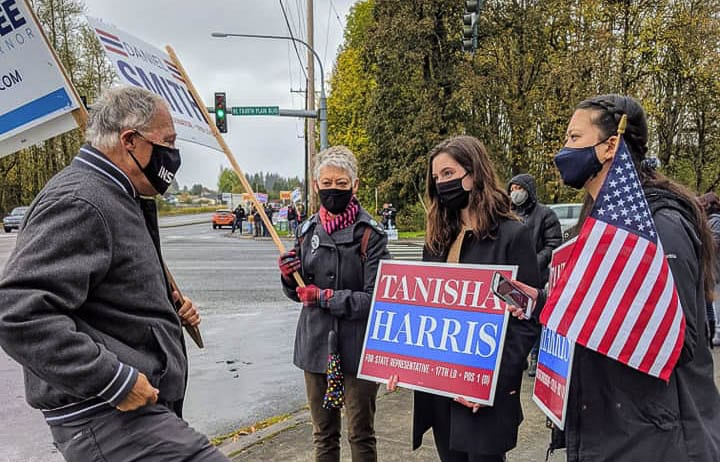 Gov. Jay Inslee joined candidate Tanisha Harris at a sign-waiving event on Saturday. Photo courtesy of Tanisha Harris Facebook
