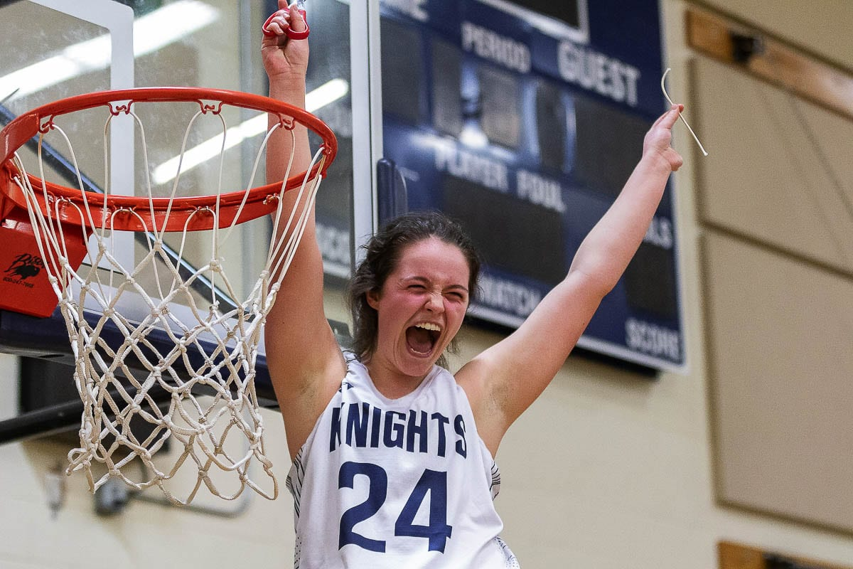 This photo of Tyra Schroeder was taken after King's Way Christian won a league title in girls basketball in 2019. Photo by Mike Schultz