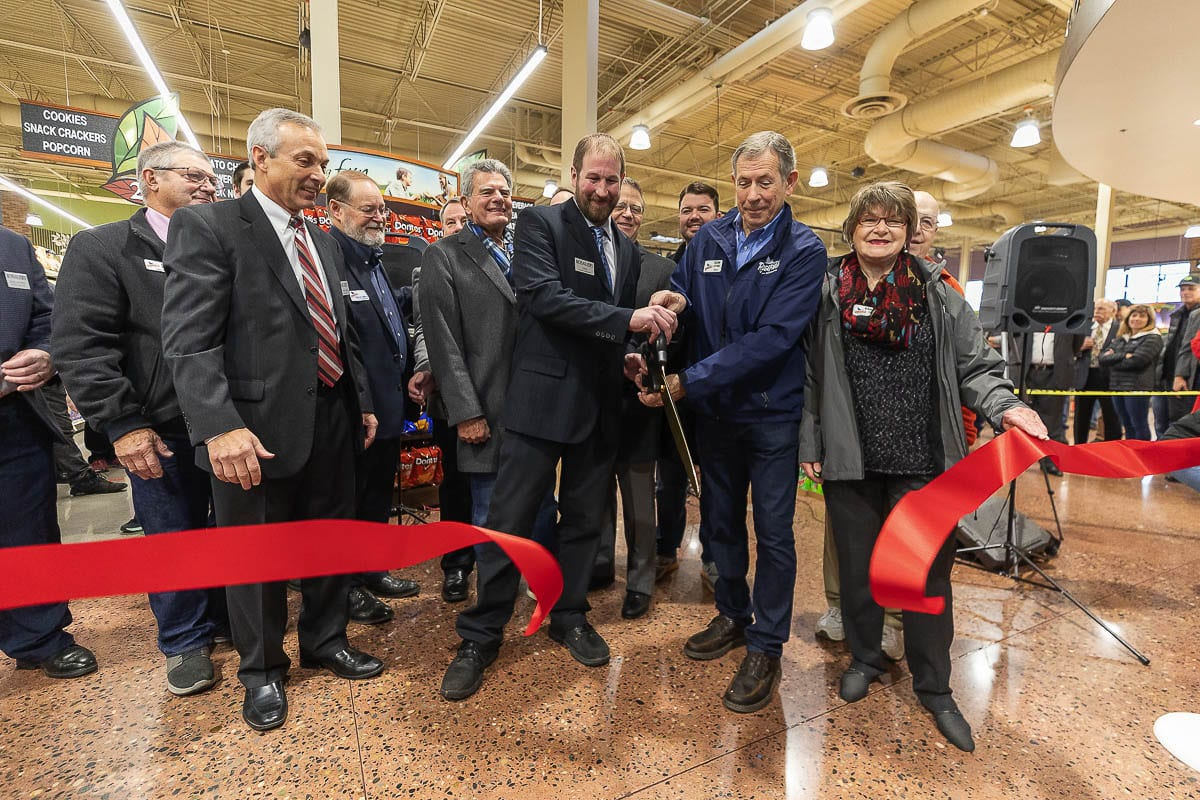 Ridgefield City council members celebrate the ribbon cutting at the grand opening of the Rosauers shopping center in December 2019. Photo by Mike Schultz