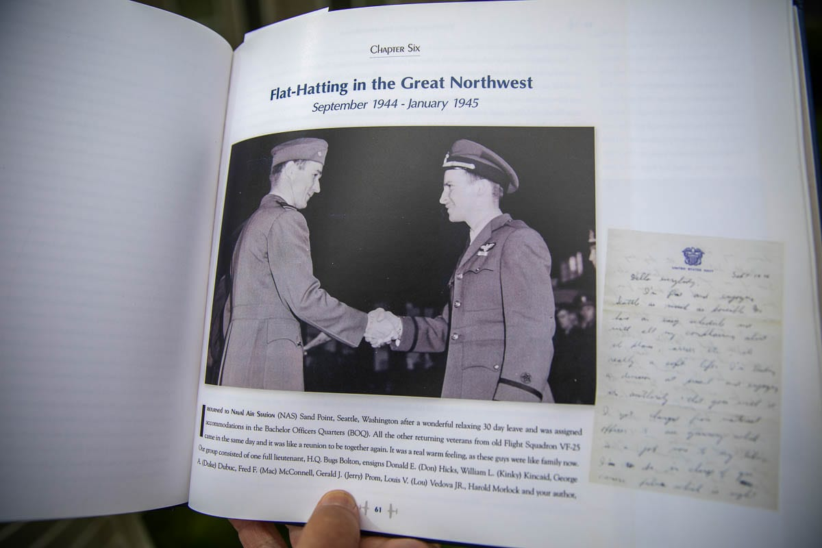 Edgar W. Haley's self-published memoir on his experiences during World War II contains many photos and memories of the men he served with in the U.S. Navy. Photo by Jacob Granneman