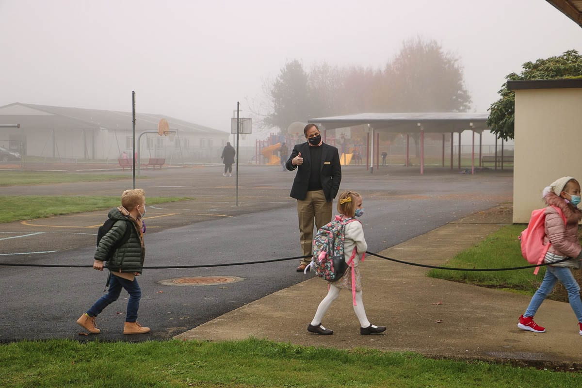 Battle Ground Public Schools Superintendent Mark Ross greets kindergarten students returning to class Monday at Glenwood Heights Primary School. Photo courtesy Battle Ground Public Schools