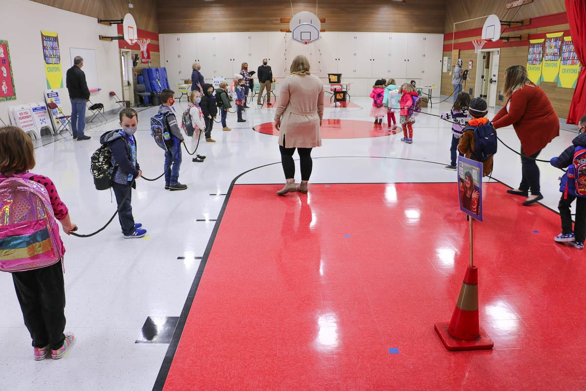 Kindergarten students line up in the gym before starting the school day Monday to have their temperatures checked. Photo courtesy Battle Ground Public Schools