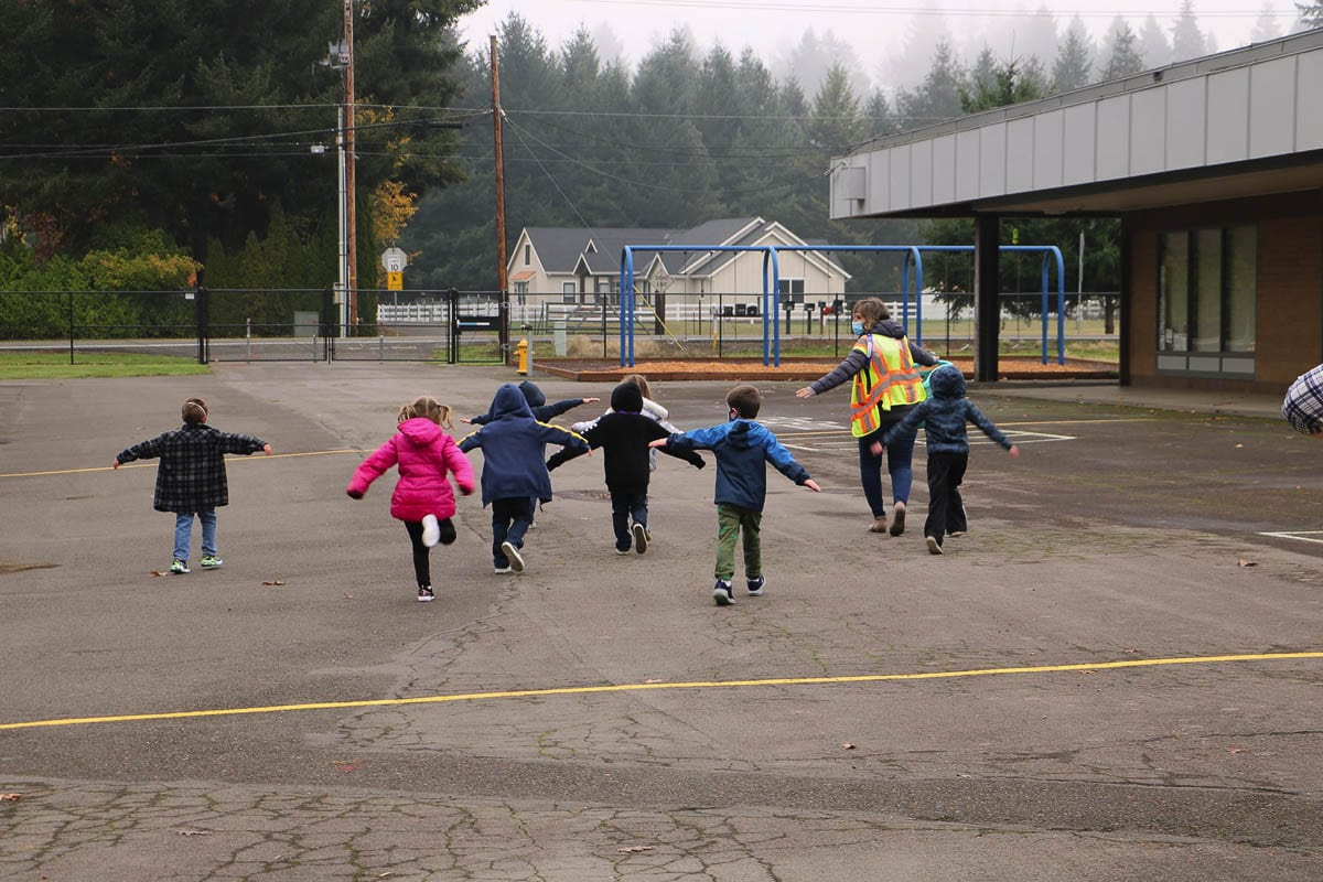 Kindergarten students are guided through the playground area at Glenwood Heights Primary School on Nov. 9. Photo courtesy Battle Ground Public Schools