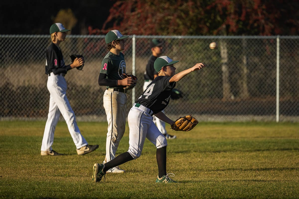 The Greenberry Athletics club warms up for a recent intersquad game at the club's new field in Camas. Photo by Mike Schultz