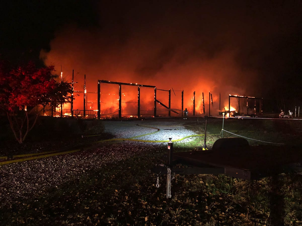 A large horse arena in the Meadow Glade neighborhood southwest of Battle Ground was destroyed by fire early Wednesday morning. Photo courtesy of Clark County Fire & Rescue