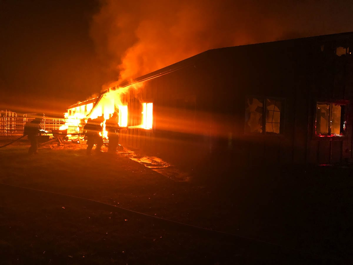 Initial reports stated the structure was heavily involved in fire with propane tanks inside the structure randomly exploding. Photo courtesy of Clark County Fire & Rescue